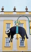 Black sheep symbol outside Welsh wool shop in Portmeirion village, Gwynedd, Wales, UK