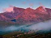 Fog at Snowdon mountain ranges in Snowdonian National Park, Wales, UK