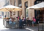 People sitting outdoors at Paul Restaurant, Beirut, Lebanon