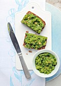 Two slices of wholemeal bread topped with a wild garlic and potato spread