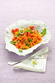 Fruity carrot salad with strawberries and basil