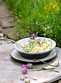 Potato salad with herbs and chive flowers