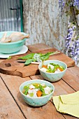 Clear chicken soup with vegetables and wild garlic