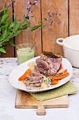 Poached leg on lamb with pesto and carrots