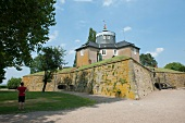 Tourist standing in front of fort at Steinhude, Lower Saxony, Germany