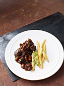 Wild boar goulash with elderberry sauce and chanterelle mushrooms served with potato orzo pasta
