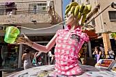 Doll at fruit juice stand at Sheinkin street, Tel Aviv, Isreal