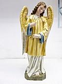 Restored Nayivity angel figure in golden robe