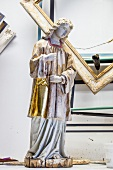 Half restored nayivity angel figure with golden robe