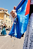 Close-up of rosary in hand, Sardinia, Italy