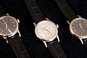 Close-up of three luxurious watches on black background at Vallee de Joux, Switzerland