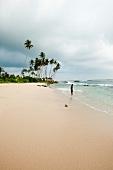 View of man on beach at Weligama, Sri Lanka