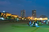 View of people at Galle Face Green skyscrapers at night, Colombo, Sri Lanka