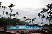 View of pool and palm trees at Barberyn Reef Ayurveda Resort, Weligama, Sri Lanka