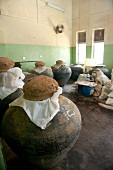 View of old pots covered with cloth and clay lid at Ayurveda Health Centre in Sri Lanka