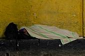 Man sleeping on street, Sri Lanka