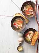 Fish and prawn stew with fennel, orange aioli, bread and eggs
