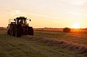Tractor on Tempelhof field garden at sunset in Berlin, Germany