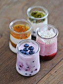 Glasses of homemade creamy yogurt with fruit