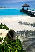 View of jetty with blue sea near Veligandu Huraa resort, Maldives