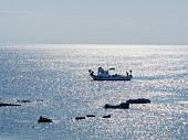 View of fishing boat in sea in Bozcaada, Aegean, Turkey