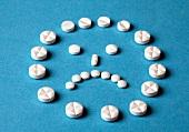trauriger Smiley aus Tabletten X