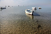 View of boats in sea at Badavut beach in Ayvalik, Aegean, Turkey