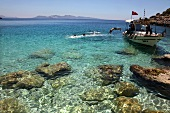 View of shallow water and people swimming in sea, Ayvalik, Aegean, Turkey
