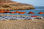 Sun loungers and sun umbrellas on Palamutbuku beach, Aegean Region, Turkey