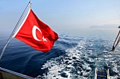 Flag of Turkey on boat in Dataca and Knidos, Turkey