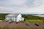 View of building and cars, Highlands National Park, Cape Breton Island, Canada