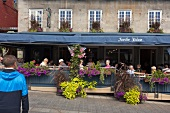 People sitting outside Restaurant Jardin Nelson on Place Jacques-Cartier, Montreal, Canada