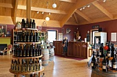 View of women at counter and different wines on shelf, Nova Scotia, Canada