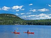 People in boats using kayaking at Pyramid Lake, Jasper National Park, Alberta, Canada