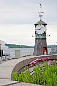 Grandfather clock at boardwalk in Aker Brygge, Oslo, Norway