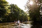 People kayaking in lake Ratzeburg, Wakenitzrestaurant, Schleswig Holstein, Germany