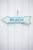 Beach written on arrow shaped sign board, Haffkrug, Holstein, Schleswig Holstein, Germany