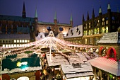 Lubeck Christmas market decorated with lights in front of Town Hall, Germany