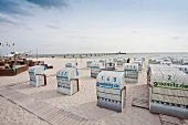 Hooded beach chairs at Gromitz beach in Schleswig Holstein, Germany