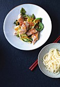 Asian style red snapper with pak choi on plate