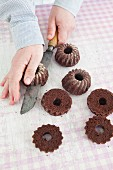Mini Black Forest gateaux Bundt cakes being made: chocolate cakes being cut in half horizontally
