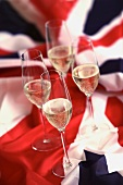 Four glasses of champagne on a Union Jack