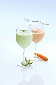 A cucumber and a carrot drink in glasses