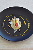 White asparagus in a pool of sauce (Galicia, Spain)