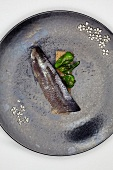 A sardine with pimientos de padron (Galicia, Spain)
