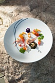 An appetiser plate featuring char, crayfish, apple and radishes