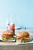 Homemade cheese burgers with wholemeal buns and sauerkraut