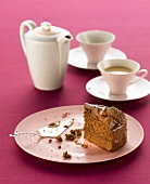 A slice of chocolate cake and cups of tea