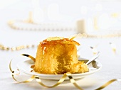 An English pudding with candied orange zest for Christmas dinner