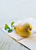 A fresh pear with leaves